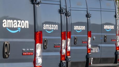 Amazon.com delivery trucks in Richmond, California, U.S., on Tuesday, Oct. 13, 2020.