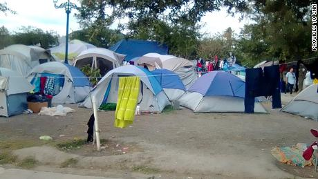 A tent city has been erected by migrants in a public park in Reynosa, Mexico. The trees in the park are connected by clothes lines as migrants, mostly from Central America, make the park their home