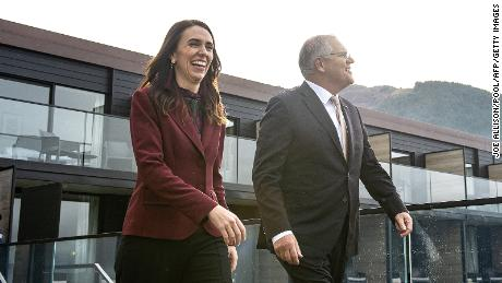 New Zealand's Prime Minister Jacinda Ardern walks with Australia's Prime Minister Scott Morrison ahead of the Australia-New Zealand Leaders' Meeting in Queenstown on May 31, 2021.