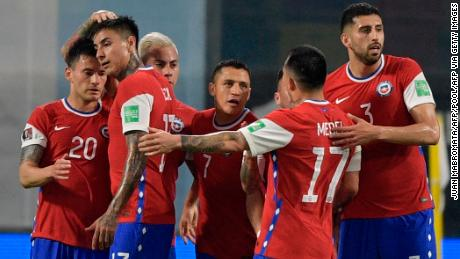 The players from Chile celebrate Alexis Sanchez's equalizer.