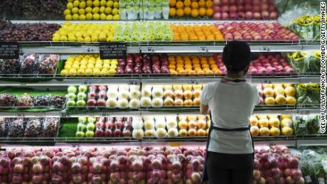 A sales assistant arranges fruit at the fresh produce section in the supermarket at the SM City Bacoor shopping mall in Bacoor, Cavite province, the Philippines, on June 3, 2021.