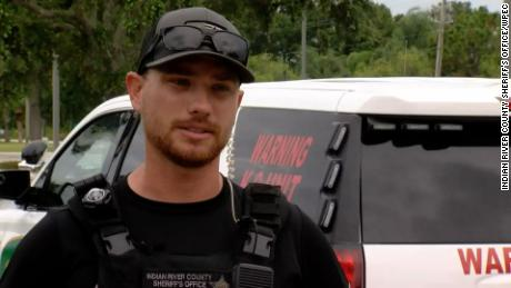 """Deputy Jacob Curby says the suspect """"overhand threw this two-month-old at me from about six feet away."""""""
