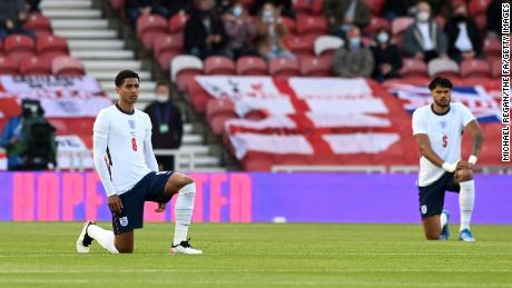 England players Jude Bellingham and Tyrone Mings of England kneel ahead of the international friendly against Austria at Riverside Stadium on 02 June 2021 in Middlesbrough.
