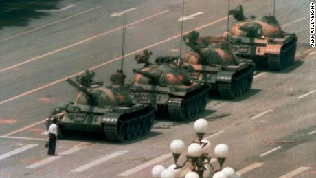 In this 1989 photo, a man stands alone to block a line of tanks heading east on Beijing's Cangan Blvd. in Tiananmen Square.