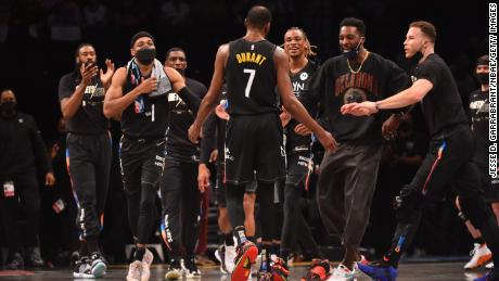 Durant and his teammates celebrate during the game against the Bucks.