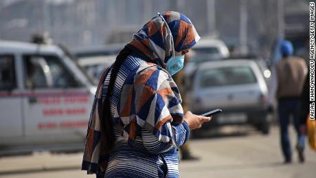 A woman using her cellphone in Srinagar, India. Photo by Faisal Khan/Anadolu Agency via Getty Images