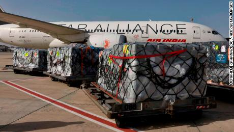 Workers load medical aid on an Air India plane bound for India, at Israel's Ben Gurion airport near Tel Aviv, on May 4.