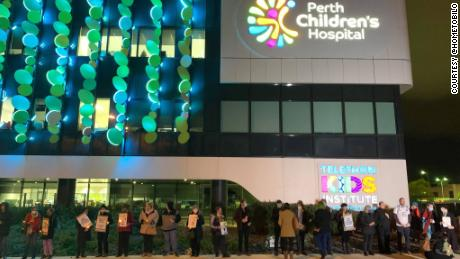 Supporters hold a vigil outside Perth Children's Hospital, where Tharnicaa is receiving medical care.