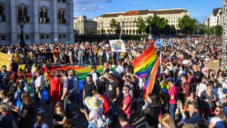 """Participants gather near parliament in Budapest on June 14, 2021, during a demonstration against the Hungarian government's draft bill seeking to ban the """"promotion"""" of homosexuality in schools."""