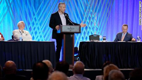 Southern Baptist Convention President J.D. Greear, center, speaks during the executive committee plenary session at the annual Southern Baptist Convention meeting Monday, June 14, 2021, in Nashville, Tennessee.