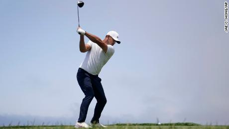 Koepka hits from the fourth tee during the first round of the U.S. Open.
