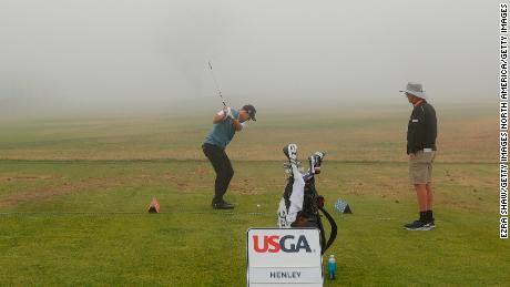 Henley plays on the practice range during a fog-delayed first round of the 2021 U.S. Open.