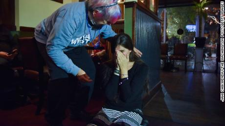 Roem falls to her knees after receiving a call from Joe Biden congratulating her on her 2017 victory at an election observation party in Gainesville, Virginia.