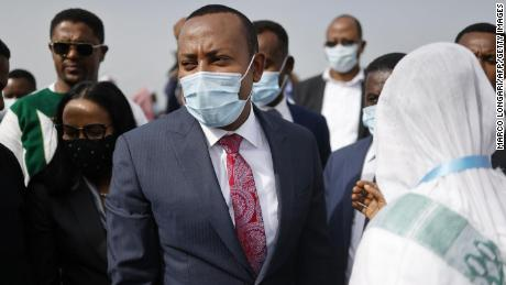 Ethiopian Prime Minister Abiy Ahmed (C) arrives in the city of Jimma on June 16.