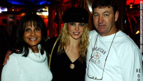 Britney Spears (center) with her parents, Lynne and Jamie Spears.