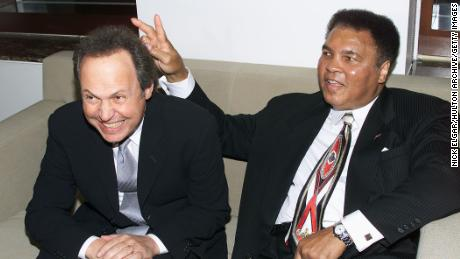 Billy Crystal and Muhammad Ali at Audemars Piguet's Time To Give Celebrity Watch Auction For Charity, held at Christie's Auction House in New York City in 2000.