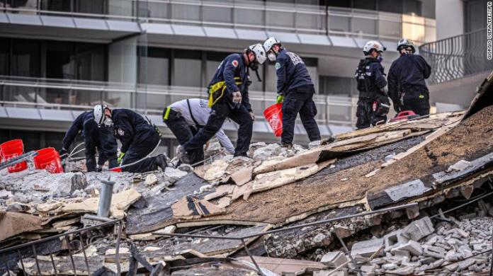 Members of the South Florida Urban Search and Rescue team work in the rubble.