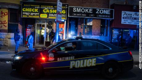 A Baltimore police officer patrols Friday, April 17, 2020, in the area of unrest after Freddie Gray, who lived nearby, was arrested more than five years ago.