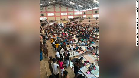 Hundreds of families take shelter in the sport center of the city of Carrefour, in the suburbs of Port-au-Prince, on June 16.