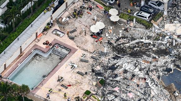 Search and rescue personnel work on site after the partial collapse of the Champlain Towers South.