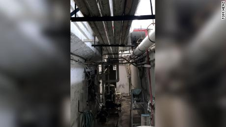 A newly obtained 2018 photograph shows the earlier stages of a crack in the concrete of the pool equipment room in the Surfside, Florida, building that collapsed. The 2018 photograph, shared with CNN by Tom Henz, a mechanical engineer whose firm did an electrical and mechanical inspection of the Champlain Towers South building that year as part of its 40-year recertification process, shows a crack around the edge of a beam running along the top of the room.