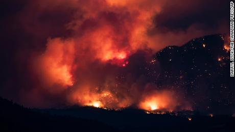 A wildfire burns on the side of a mountain in Lytton on July 1.