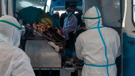 Health workers arrive with a patient at the Chris Hani Baragwanath Academic Hospital's COVID-19 facility, in Johannesburg, Monday, June 21, 2021.