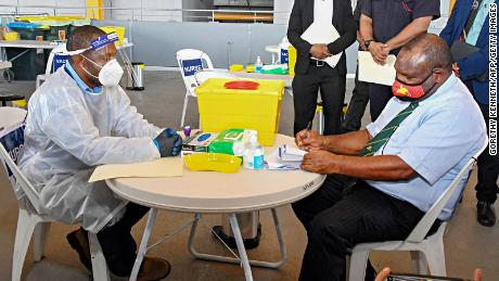 Papua New Guinea's Prime Minister James Marape prepares to receive a dose of the AstraZeneca Covid-19 vaccine in Port Moresby.