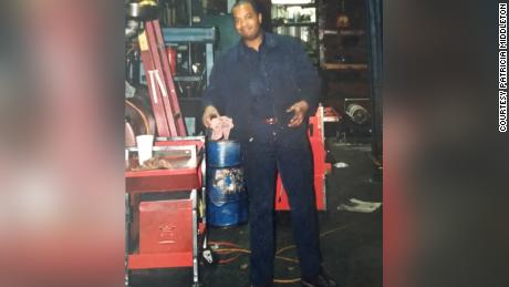 Middleton's father, Kevin Wayne Middleton Sr., works in his auto repair shop in the 1990s.