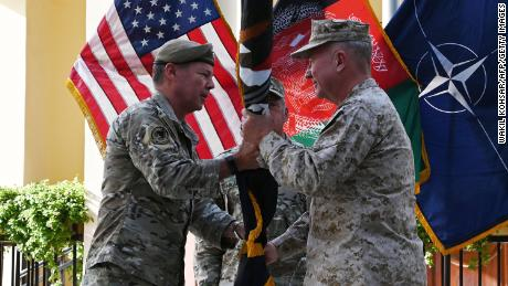 General Austin Miller, the top US commander in Afghanistan, passes the flag of US-led Resolute Support mission to General Kenneth McKenzie, the head of US Central Command, on July 12.