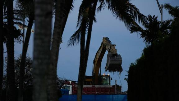 An excavator clears rubble at the site of the Champlain Towers South condo building collapse and demolition, Thursdayy.