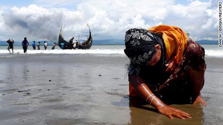 Danish Siddiqui won a Pulitzer Prize for his work on the Rohingya refugee crisis. This photo shows a Rohingya woman touching the shore after crossing the Bangladesh-Myanmar border.