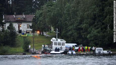 Police and emergency services gather following the massacre at a summer youth camp on July 22, 2011 on Utoya Island, Norway.