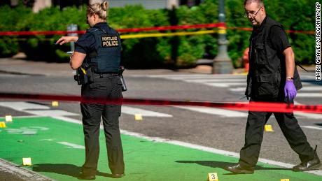 Police investigate an overnight shooting Saturday, July 17, in Portland, Oregon.