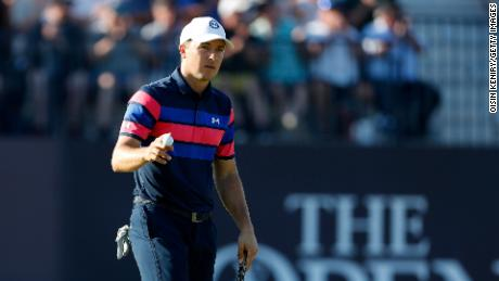 Spieth reacts on the green of the 18th hole on day four of the Open.