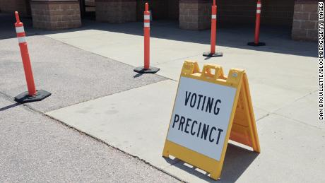 """A """"Voting Precinct"""" sign stands on display outside a polling location in Sioux Falls, South Dakota, June 2020."""