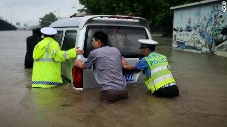 Heavy floods inundated roads and washed away cars.
