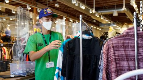 An employee sorts a rack at 2nd Street second hand store in the Fairfax district of Los Angeles.
