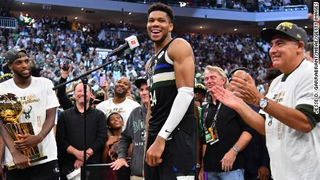 Giannis Antetokounmpo reacts after winning the NBA Finals.