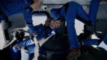 Jeff Bezos in the cabin of one of his Blue Origin spaceflights