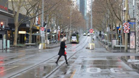 A woman in Melbourne's nearly empty city center during this month's lockdown.