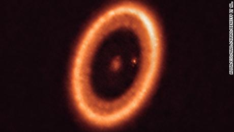This image shows a planetary system 400 light-years away that is still forming.
