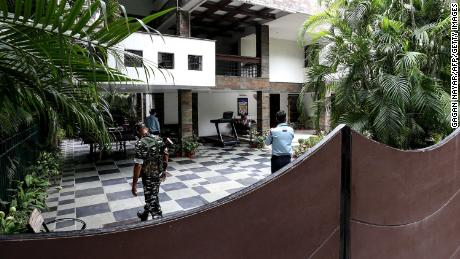 Security personnel at the residence of Sudhir Agrawal, managing director of Dainik Bhaskar, which was raided Thursday by Indian tax authorities.