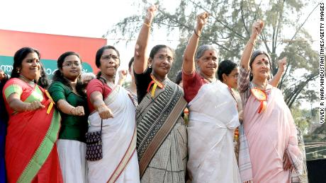 """Women gather to participate in the 620-kilometer """"Women's Wall"""" against gender discrimination in Kerala, 2019."""