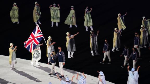 British flag-bearers Hannah Mills and Mohamed Sbihi lead out the team during the opening ceremony's parade of nations. Sbihi, a rower, made history as Great Britain's first Muslim flag-bearer.