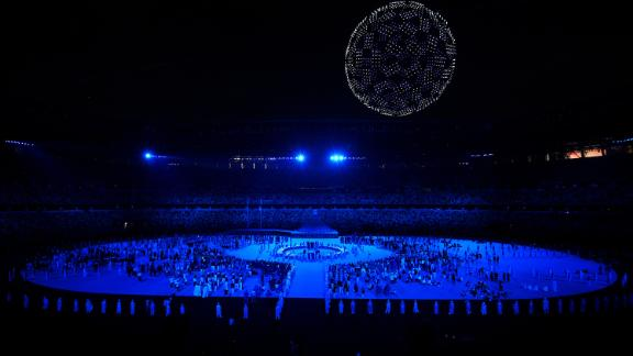 """During one portion of the opening ceremony, there were 1,800 drones flying over the stadium to form a globe in the night sky. As the glowing drones soared over the stadium, performers sang """"Imagine"""" by John Lennon."""