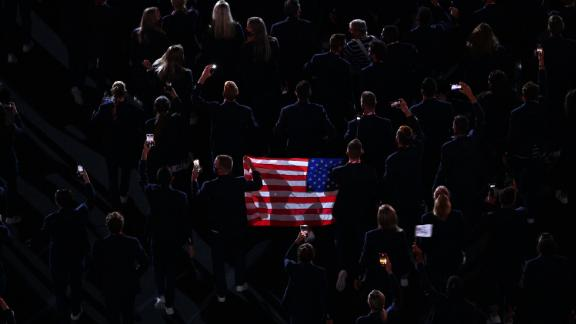 US athletes hold an American flag during the parade of nations.