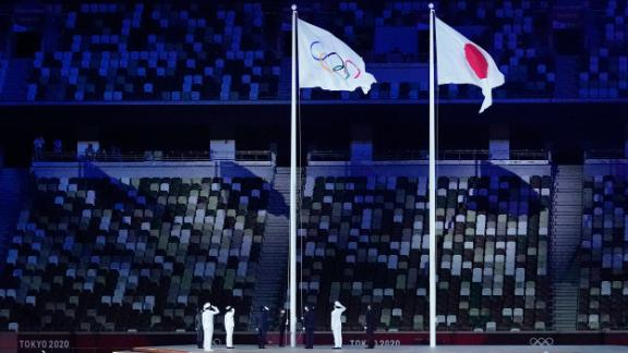 The Olympic flag is raised near the end of the opening ceremony.