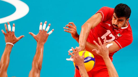 Iran's Meisam Salehi spikes the ball during a volleyball match against Venezuela on July 26.