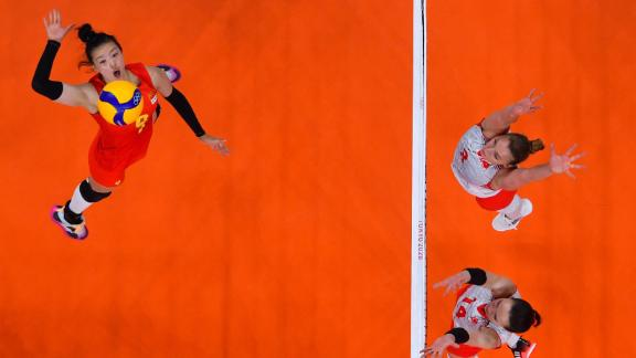 China's Zhang Changning spikes the ball in a preliminary-round volleyball match against Turkey on July 25.